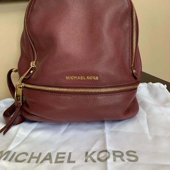 b926025cdadf Michael Kors Rhea Cherry Leather Backpack. M_5c7599262e14781a6d1f9cf1